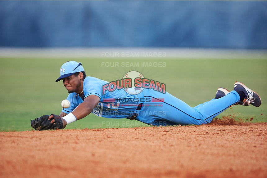 SCF Manatees shortstop Austin James (12) makes a diving stop during a game against the College of Central Florida Patriots on February 8, 2017 at Robert C. Wynn Field in Bradenton, Florida.  SCF defeated Central Florida 6-5 in eleven innings.  (Mike Janes/Four Seam Images)