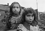 Family of children who make their living collecting garbage in Bogota, Colombia - Child labor as seen around the world between 1979 and 1980 – Photographer Jean Pierre Laffont, touched by the suffering of child workers, chronicled their plight in 12 countries over the course of one year.  Laffont was awarded The World Press Award and Madeline Ross Award among many others for his work.