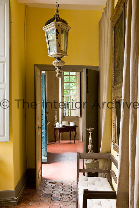 A narrow corridor leads into the tiled entrance hall in this restored 18th century property