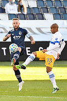 KANSAS CITY, KS - NOVEMBER 22: Johnny Russell #7 of Sporting Kansas City wins the ball against Judson #93 San Jose Earthquakes during a game between San Jose Earthquakes and Sporting Kansas City at Children's Mercy Park on November 22, 2020 in Kansas City, Kansas.