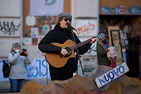 """Ivan Talarico (Singer, Songwriter, Poet, Theater Actor).<br /> <br /> Rome, 03/12/2020. Today, the Nuovo Cinema Palazzo Community held a second public assembly (1.) in Rome's San Lorenzo district to protest against the eviction of the """"Nuovo Cinema Palazzo"""" completed by the Italian police forces in the early morning of the 25th of November and to demonstrate against the violent reaction of the Police forces when, in the evening of the same day, a large demo asked to have the chance to hold a public assembly in the square (Piazza dei Sanniti) of the cinema (2.). The public assembly of today saw the participation and the support & solidarity of the representatives of movements, actors, musicians, students, artists, politicians, and citizens of San Lorenzo who told their stories and memories related to the famous Rome's Art and culture occupation (For example, actor Marcello Fonte, Best Actor Award of the 2018 Cannes Film Festival for the film Dogman, was among the first group of occupiers of the Nuovo Cinema Palazzo). The assembly of the 1st December was interrupted due to the bad weather (3).<br /> The Nuovo Cinema Palazzo was occupied the 15th of April 2011, when citizens, movements, workers of the entertainment industry reopened the former """"Palazzo Cinema"""" to prevent the opening of a casino/gambling space. The illegal occupation was intended as a public hub of art, culture, sport and politics, an open place for exchange, discussion, studies, caring and sharing.<br /> <br /> Footnotes & Links:<br /> 1. http://bit.do/fLCpE<br /> 2. Demo And Clashes Against Nuovo Cinema Palazzo Eviction in Rome's San Lorenzo: http://bit.do/fLxgz<br /> 3. http://bit.do/fLCr3<br /> Previous Stories about Nuovo Cinema Palazzo: 14.04.2018 - Nuovo Cinema Palazzo's Concert: """"7 Anni di CasiNò 