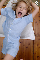 Girl (6-7) holding pillow and screaming, portrait (Licence this image exclusively with Getty: http://www.gettyimages.com/detail/sb10065474de-001 )