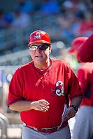 Springfield Cardinals manager Joe Kruzel (13) walks through the dugout on May 19, 2019, at Arvest Ballpark in Springdale, Arkansas. (Jason Ivester/Four Seam Images)