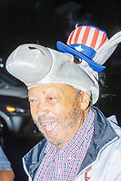 """A man wore a donkey-shaped hat as people gathered to watch the 2020 Democratic National Convention at a """"Ridin' with Biden"""" Drive-In Theater viewing event at Suffolk Downs in Boston, Massachusetts, on Wed., Aug. 19, 2020."""