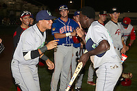 Jamestown Jammers outfielder Juancito Martinez #3 and Viosergy Rosa celebrate Martinez being awarded the Most Valuable Player after the NY-Penn League All-Star Game at Eastwood Field on August 14, 2012 in Niles, Ohio.  National League defeated the American League 8-1.  (Mike Janes/Four Seam Images)