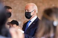 United States President Joe Biden speaks to workers as he picks up tacos during a visit to Las Gemelas Restaurant  in Washington, DC, USA, 05 May 2021.United States President Joe Biden picks up tacos during a visit to Las Gemelas Restaurant  in Union Market to highlight the successes of the American Rescue Plan (ARP) in Washington, DC, USA, 05 May 2021.  Las Gemelas is a beneficiary of relief funding from the pilot program Restaurant Revitalization Fund.  ìThe ARPís Restaurant Revitalization Fund provides $28.6 billion in direct relief to restaurants and food and beverage establishments, and prioritizes restaurants that are women-owned, veteran-owned, and owned by other socially and economically disadvantaged individuals.î<br /> Credit: Jim LoScalzo / Pool via CNP/AdMedia