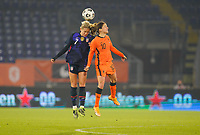 BREDA, NETHERLANDS - NOVEMBER 27: Abby Dahlkemper #7 of the United States battles in the air Daniëlle van de Donk #10 of the Netherlands during a game between Netherlands and USWNT at Rat Verlegh Stadion on November 27, 2020 in Breda, Netherlands.