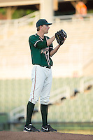 Greensboro Grasshoppers relief pitcher Ben Meyer (23) looks to his catcher for the sign against the Kannapolis Intimidators at Intimidators Stadium on July 17, 2016 in Greensboro, North Carolina.  The Grasshoppers defeated the Intimidators 5-4 in game two of a double-header.  (Brian Westerholt/Four Seam Images)