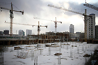China. Jilin Province. A construction site in the centre of the town of Yanji, close to the border with North Korea. The town is part of the Korean Autonomous Prefecture in the north-east of the country. 2011