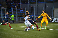 Lorient, France. - Sunday, February 8, 2015:  Laura Georges (4) and goalkeeper Sarah Bouhaddi (16) of France defend Christen Press (23) of the USWNT. France defeated the USWNT 2-0 during an international friendly at the Stade du Moustoir.