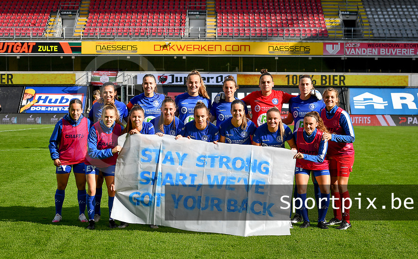 "Gent's players pictured posing for the banner "" stay strong Shari , We've got your back ' before a female soccer game between Zulte Waregem and the KAA Gent Ladies on the fourth matchday of the 2020 - 2021 season of Belgian Scooore Womens Super League , saturday 10 October 2020 in Waregem , Belgium . PHOTO SPORTPIX.BE 