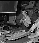 Pittsburgh PA:  Robert Pavuchak getting ready to trim prints to complete a job while Brady Stewart Sr is preparing a print for mounting on cardboard.  Our copy camera is in the background and a mounting press in the foreground.  We continued to use the same equipment until 1991.