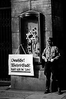 "On April 1st, 1933, the boycott which was announced by the Nationalsocialistic party began.  Placard reads, ""Germans, defend yourselves, do not buy from Jews,"" at the Jewish Tietz store.  Berlin.  New York Times Paris Bureau Collection.  (USIA)<br /> Exact Date Shot Unknown<br /> NARA FILE #:  306-NT-178018<br /> WAR & CONFLICT BOOK #:  985"