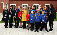 Pictured: Hillary Clinton shows how to pose for the cameras to young pupils from Narberth, Pentrehafod and Blaen-y-maes Primary Schools, at Swansea University Bay Campus. Saturday 14 October 2017<br />