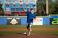 Dr. Anthony Schuster throws out the ceremonial first pitch at a Dunedin Blue Jays game against the Clearwater Threshers on April 8, 2017 at Florida Auto Exchange Stadium in Dunedin, Florida.  Dunedin defeated Clearwater 12-6.  (Mike Janes/Four Seam Images)