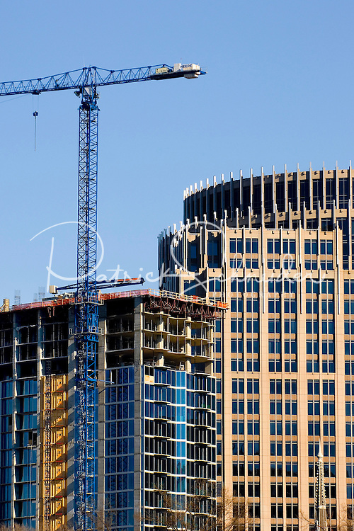 """02/26/07:  Verticalphoto of the Charlotte, NC skyline with a skyscraper under construction. Charlotte is North Carolina's largest city and the 20th-largest city in the United States. Charlotte is one of the country's fastest-growing cities, Between 1990 and 2006, Charlotte's population jumped 46 percent, to 630,478. In 2006, the Charlotte MSA had an estimated population of 1,583,016. .. In 2008, Charlotte was chosen the """"Best Place to Live in America"""" by relocate-america.com in its annual ranking, based on factors including employment opportunities, crime rates, and housing affordability.....February 26, 2007. By: Patrick Schneider- Patrick Schneider Photography..."""