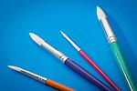 Paintbrushes on blue background