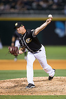 Charlotte Knights relief pitcher Eric Surkamp (23) in action against the Louisville Bats at BB&T BallPark on May 12, 2015 in Charlotte, North Carolina.  The Knights defeated the Bats 4-0.  (Brian Westerholt/Four Seam Images)