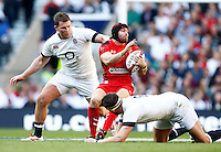 Photo: Richard Lane/Richard Lane Photography. England v Wales. RBS Six Nations. 09/03/2014. Wales' Leigh Halfpenny is tackled by England's Dylan Hartley and Tom Wood.