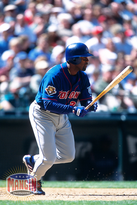 SEATTLE, WA - Carlos Delgado of the Toronto Blue Jays bats during a game against the Seattle Mariners at Safeco Field in Seattle, WA in 2001. Photo by Brad Mangin