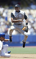 Tony Womack of the Arizona Diamondbacks turns a double play during a 2002 MLB season game against the Los Angeles Dodgers at Dodger Stadium, in Los Angeles, California. (Larry Goren/Four Seam Images)