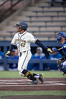 Michigan Wolverines outfielder Jordan Nwogu (42) follows through on his swing against the Indiana State Sycamores on April 10, 2019 in the NCAA baseball game at Ray Fisher Stadium in Ann Arbor, Michigan. Michigan defeated Indiana State 6-4. (Andrew Woolley/Four Seam Images)