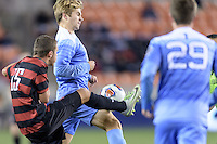 Houston, TX - Friday December 9, 2016: Jared Gilbey (15) of the Stanford Cardinal attempts to kick the ball away from  Jack Skahan (35) of the North Carolina Tar Heels at the NCAA Men's Soccer Semifinals at BBVA Compass Stadium in Houston Texas.