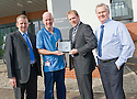 ::  SERCO :: RENAL UNIT WIFI LAUNCH :: SERCO CONTRACT DIRECTOR MIKE MACKAY PRESENTS THE NEW IPAD TO SENIOR STAFF NURSE KEN WEIR TO OFFICIALLY LAUNCH THE NEW RENAL UNIT WIFI SERVICE FOR PATIENTS AONG WITH OPERATIONS MANAGER IAIN SHAW (LEFT) AND  IT MANAGER GORDON REID (RIGHT) ::