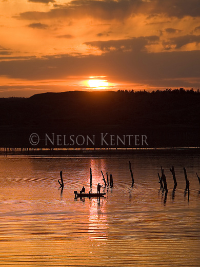 Fishermen in boat on the Missouri River above Fort Peck Reservoir in Montana