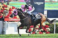 10 December 2017, Hong Kong - Derek Leung Ka-chun on the John Moore trained BEAUTY GENERATION (10) wins Race 7, The Longines Hong Kong Mile (G1, 1600M) at Sha Tin Racecourse Hong Kong. Photo Sydney Low