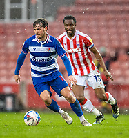 6th February 2021; Bet365 Stadium, Stoke, Staffordshire, England; English Football League Championship Football, Stoke City versus Reading; John Swift of Reading under pressure from John Obi Mikel of Stoke City