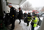 CHESHIRE, CT - 30 DECEMBER 2017 - 123017JW09.jpg -- Cheshire Police Officers, Fire Department, and Campion Ambulance members bring in the  gifts to replace the ones that were stolen from the Maher family. The gifts were in the family car that was stolen from a family members home in Waterbury on Christmas Day. Jonathan Wilcox Republican-American