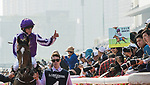 Jockey Ryan Moore riding Highland Reel celebrates after winning the Longines Hong Kong Vase (G1, 2400m) during the Longines Hong Kong International Races at Sha Tin Racecourse on December 10 2017, in Hong Kong, Hong Kong. Photo by Victor Fraile / Power Sport Images