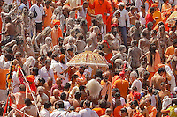 the naga baba and sadhu approch Har Ki Pauri.ghat  in Hariwar India to take the holy bath into Ganga river to take human out of the circle of life & death ( stage known as Moksha )