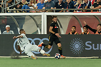 FOXBOROUGH, MA - AUGUST 4: Brandon Bye #15 of New England Revolution tackles Diego Rossi #9 of Los Angeles FC during a game between Los Angeles FC and New England Revolution at Gillette Stadium on August 3, 2019 in Foxborough, Massachusetts.