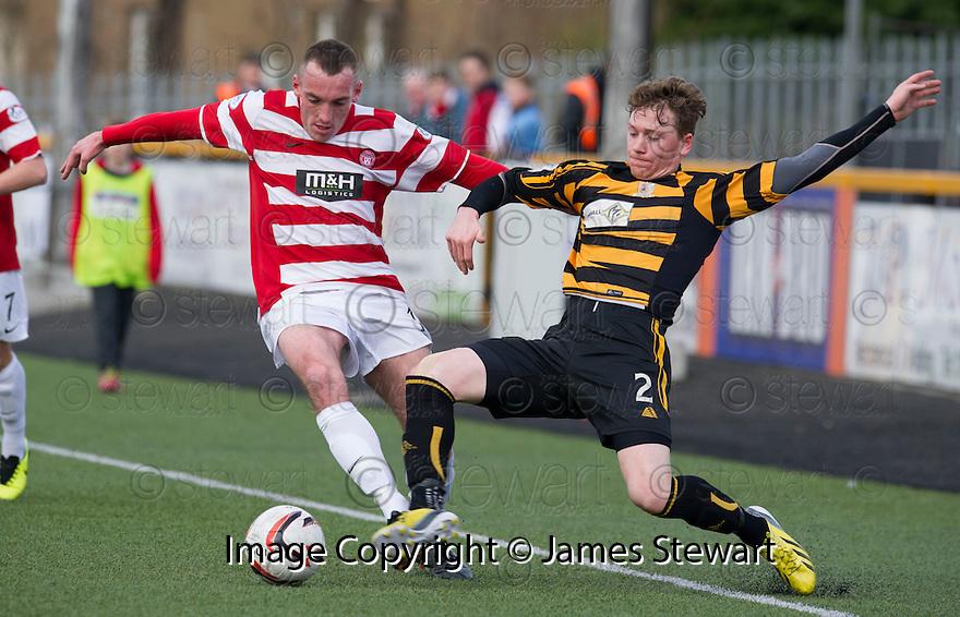 Hamilton's Darian MacKinnon and Alloa's Michael Doyle challenge for the ball.