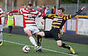 Hamilton's Darian MacKinnon and Alloa's Michael Doyle challenge for the ball.
