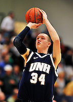 29 January 2012: University of New Hampshire Wildcat forward Brian Benson, a Senior from Rochester, NY, warms up at half-time of a game against the University of Vermont Catamounts at Patrick Gymnasium in Burlington, Vermont. The Catamounts defeated the Wildcats 77-60 in America East play. Mandatory Credit: Ed Wolfstein Photo