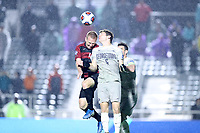 CARY, NC - DECEMBER 13: Sean Zawadzki #6 of Georgetown University and Derek Waldeck #4 of Stanford University challenge for a header during a game between Stanford and Georgetown at Sahlen's Stadium at WakeMed Soccer Park on December 13, 2019 in Cary, North Carolina.