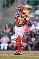 Arkansas Travelers catcher Jett Bandy (27) throws down to third after a strikeout during a game against the San Antonio Missions on May 25, 2014 at Dickey-Stephens Park in Little Rock, Arkansas.  Arkansas defeated San Antonio 3-1.  (Mike Janes/Four Seam Images)