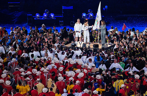 """27 JUL 2012 - LONDON, GBR - British Taekwondo competitor Sarah Stevenson (GBR) takes the Olympic Oath on behalf of the competitors  during the """"Let the Games Begin"""" section of the Opening Ceremony of the London 2012 Olympic Games in the Olympic Stadium in the Olympic Park, Stratford, London, Great Britain .(PHOTO (C) 2012 NIGEL FARROW)"""