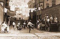 "Historical Views:  Lewis Hine Photograph  ""Playground in Tenement Alley, Boston 1909"".  Photo '78.  Reference only."