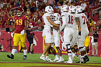 LOS ANGELES, CA - SEPTEMBER 11: Brycen Tremayne #81 and Nathaniel Peat #8 of the Stanford Cardinal celebrate after an 87 yard touchdown run by Nathaniel Peat during a game between University of Southern California and Stanford Football at Los Angeles Memorial Coliseum on September 11, 2021 in Los Angeles, California.
