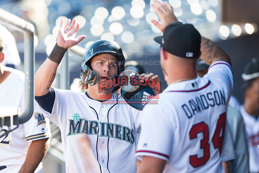 Peoria Javelinas right fielder Ian Miller (9), of the Seattle Mariners organization, is congratulated by Braxton Davidson (34) in the dugout after scoring a run during an Arizona Fall League game against the Glendale Desert Dogs at Peoria Sports Complex on October 22, 2018 in Peoria, Arizona. Glendale defeated Peoria 6-2. (Zachary Lucy/Four Seam Images)