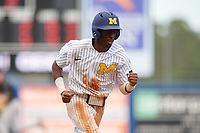 Michigan Wolverines right fielder Christan Bullock (5) scores a run during a game against Army West Point on February 18, 2018 at Tradition Field in St. Lucie, Florida.  Michigan defeated Army 7-3.  (Mike Janes/Four Seam Images)