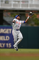 St. Lucie Mets outfielder Maikis De La Cruz (11) catches a shallow fly ball during a game against the Fort Myers Miracle on April 18, 2014 at Hammond Stadium in Fort Myers, Florida.  St. Lucie defeated Fort Myers 15-9.  (Mike Janes/Four Seam Images)
