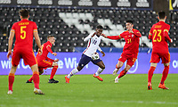 SWANSEA, WALES - NOVEMBER 12: Yunus Musah #18 of the United States moves with the ball during a game between Wales and USMNT at Liberty Stadium on November 12, 2020 in Swansea, Wales.
