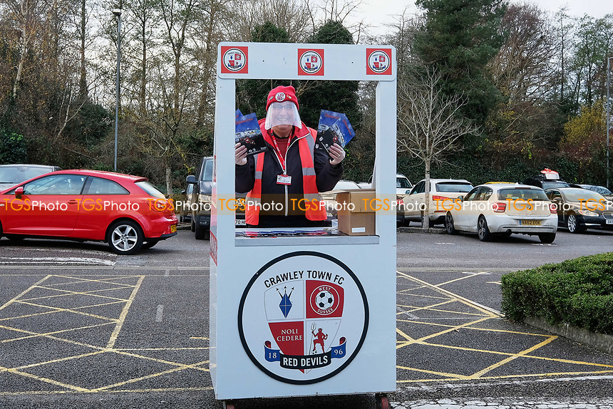 Programme seller ahead of Crawley Town vs Barrow, Sky Bet EFL League 2 Football at Broadfield Stadium on 12th December 2020