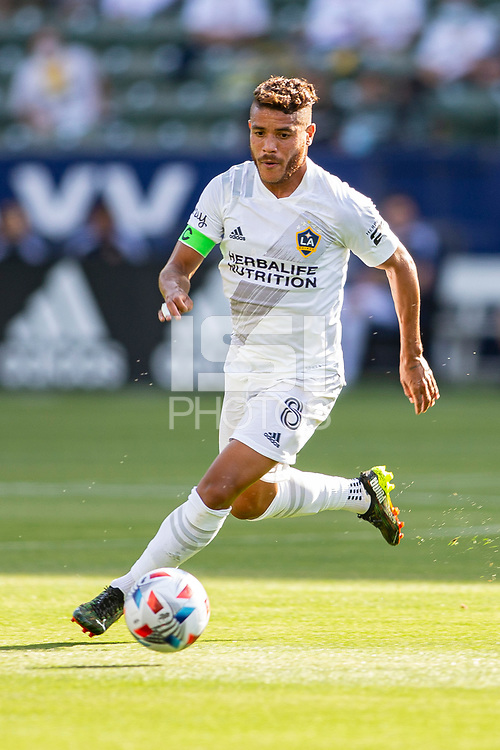 CARSON, CA - MAY 8: Jonathan dos Santos #8 of the Los Angeles Galaxy moves with the ball during a game between Los Angeles FC and Los Angeles Galaxy at Dignity Health Sports Park on May 8, 2021 in Carson, California.