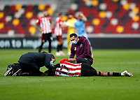 17th October 2020; Brentford Community Stadium, London, England; English Football League Championship Football, Brentford FC versus Coventry City; Ivan Toney of Brentford receiving medical treatment after lying on the pitch injured after holding his shoulder blade